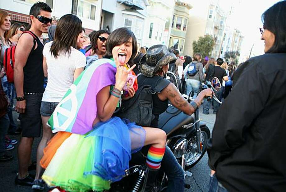 A lone bike squeezes through the crowd near the start of the 18th annual Dyke March up 16th Street from Dolores Park in San Francisco on Saturday. Photo: Kat Wade, Special To The Chronicle