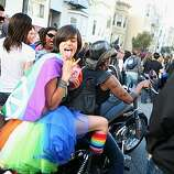 A lone bike squeezes through the crowd near the start of the 18th annual Dyke March up 16th Street from Dolores Park in San Francisco on Saturday.