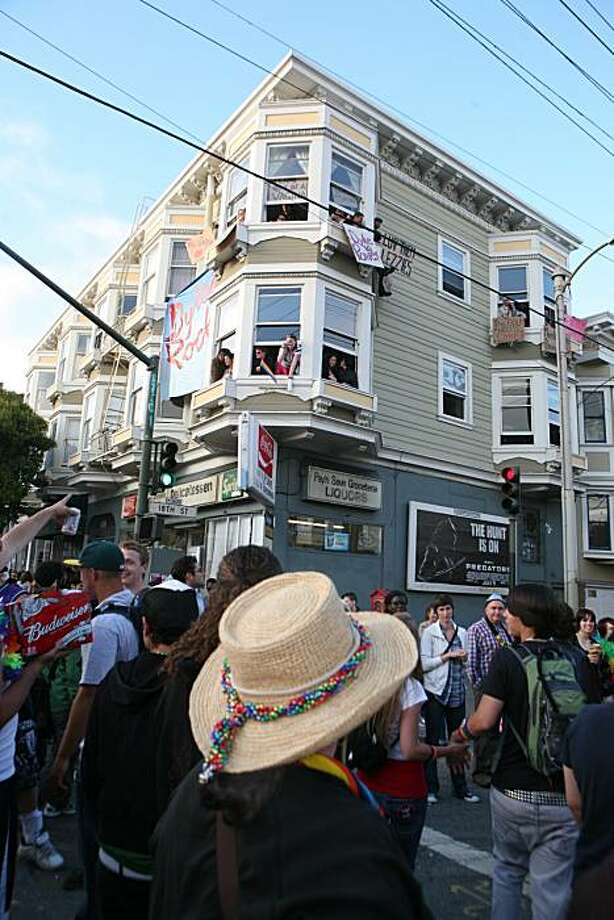 Onlookers shout encouragement and wave signs supporting the18th annual San Francisco Dyke March up 16th Street from Dolores Park in San Francisco on Saturday. Photo: Kat Wade, Special To The Chronicle