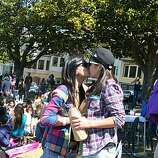 Valerie Keeranan, left, and Tassha Kohara of Oxnard kiss at the 18th annual Dyke March celebration in Dolores Park in San Francisco on Saturday.