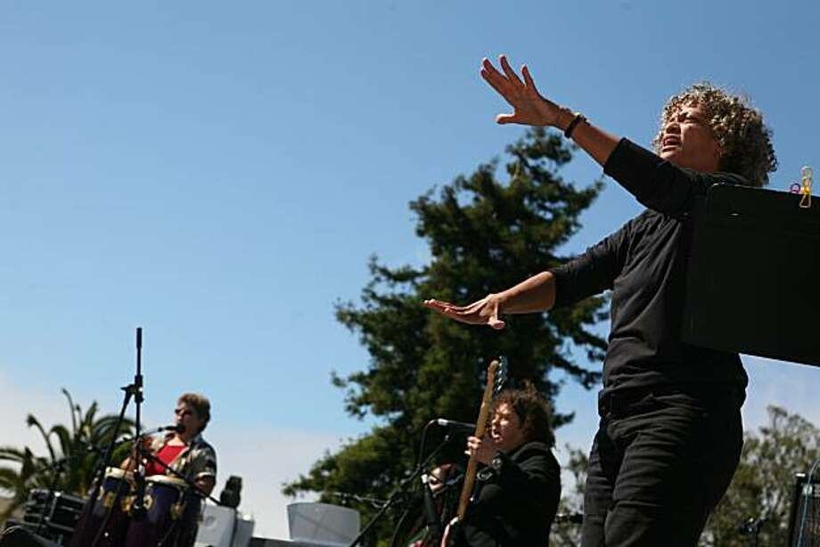 "Doralynn Folse, right, interprets the music by ""Rita and Friends"" in American Sign Language during the 18th annual Dyke March celebration in Dolores Park in San Francisco on Saturday. Photo: Kat Wade, Special To The Chronicle"