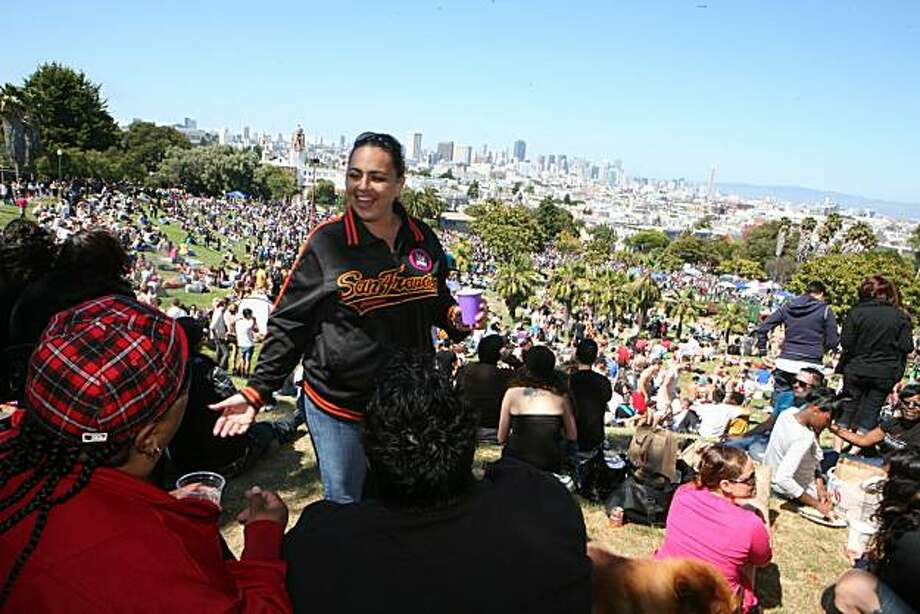 From left, Julie Torres of San Francisco, Leticia Rodriguez, of Livermore and Janet Guirola of San Francisco enjoy the celebration from the top of Dolores Park at the 18th annual Dyke March celebration in San Francisco on Saturday. Photo: Kat Wade, Special To The Chronicle