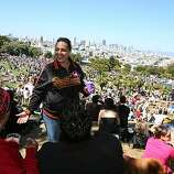 From left, Julie Torres of San Francisco, Leticia Rodriguez, of Livermore and Janet Guirola of San Francisco enjoy the celebration from the top of Dolores Park at the 18th annual Dyke March celebration in San Francisco on Saturday.