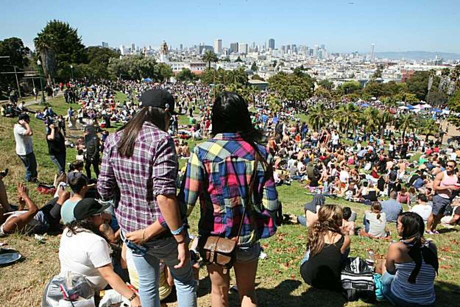 Tassha Kohara and Valerie Keeranan of Oxnard look over the huge gathering at the 18th annual Dyke March celebration in Dolores Park in San Francisco on Saturday. Photo: Kat Wade, Special To The Chronicle
