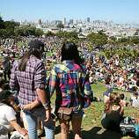 Tassha Kohara and Valerie Keeranan of Oxnard look over the huge gathering at the 18th annual Dyke March celebration in Dolores Park in San Francisco on Saturday.