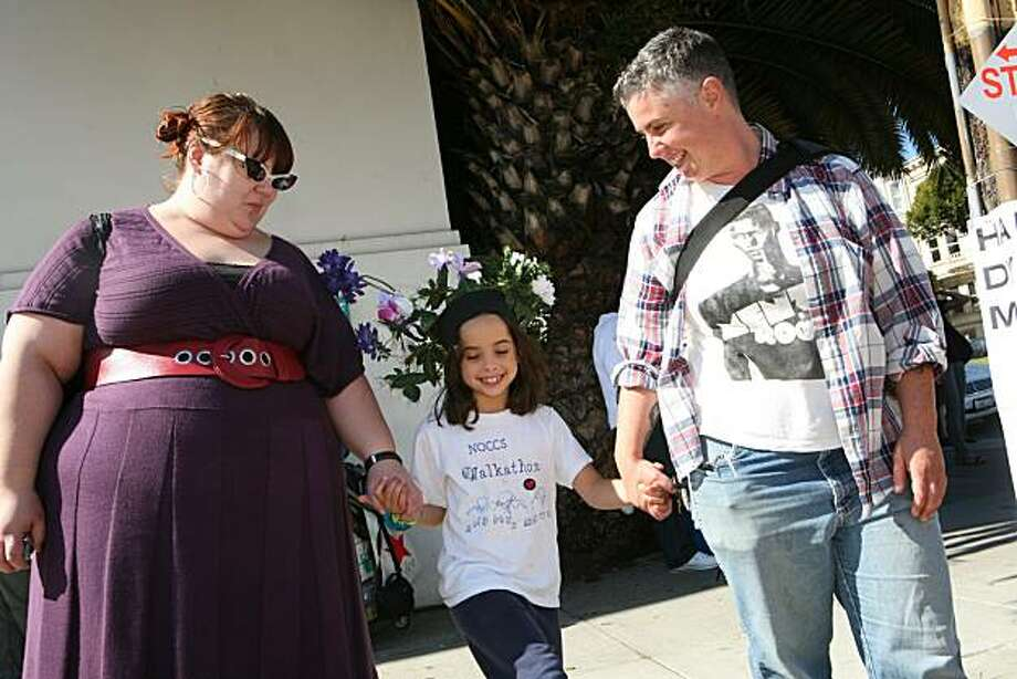 From left, Amanda Piasecki, Rudy Moon, 7, and her mom, Felix Thompson of Oakland, head to the18th annual Dyke March celebration in Dolores Park in San Francisco on Saturday. Photo: Kat Wade, Special To The Chronicle