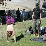 People play at acrobatics during the 18th annual Dyke March celebration in Dolores Park in San Francisco on Saturday.