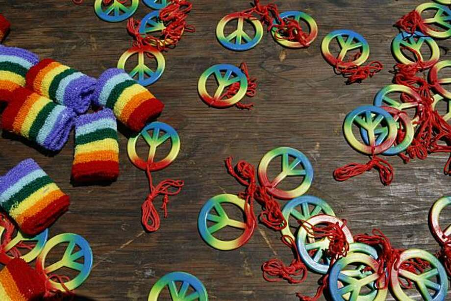 Give away prizes for spinning the wheel at the Queer Youth Pavilion during the Pride kick-off party at Civic Center Plaza on Saturday in San Francisco. Photo: John Sebastian Russo, The Chronicle