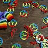Give away prizes for spinning the wheel at the Queer Youth Pavilion during the Pride kick-off party at Civic Center Plaza on Saturday in San Francisco.