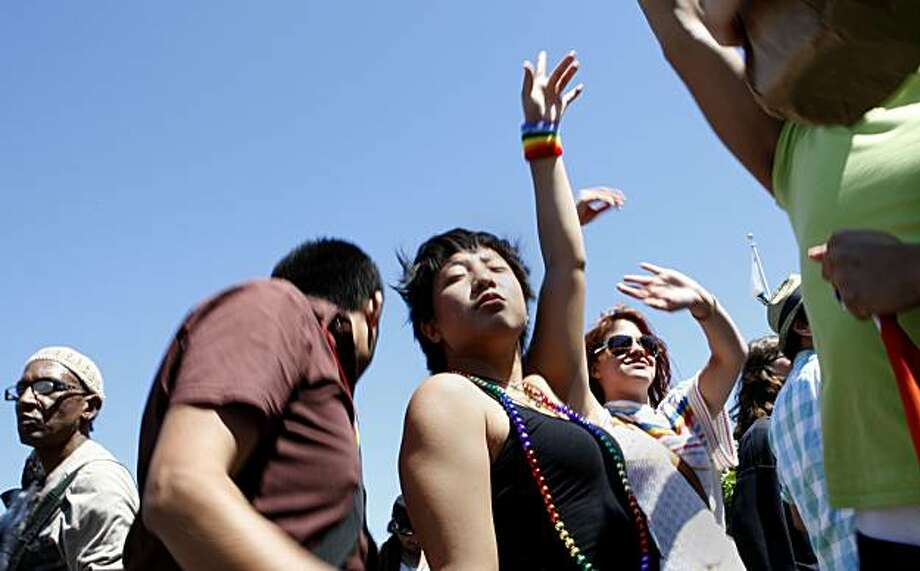 Vivian Cheng (center) of Chicago dances with friends at the Pride kick-off party at Civic Center Plaza on Saturday in San Francisco. Photo: John Sebastian Russo, The Chronicle