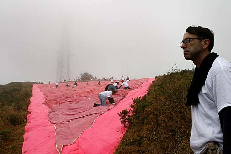 Volunteer Ron Fairley comes to the bottom of the hill to see the nearly finished pink triangle during its annual installation a hillside in Twin Peaks on Saturday, June 26, 2010 in San Francisco, Calif. Photo: John Sebastian Russo, The Chronicle