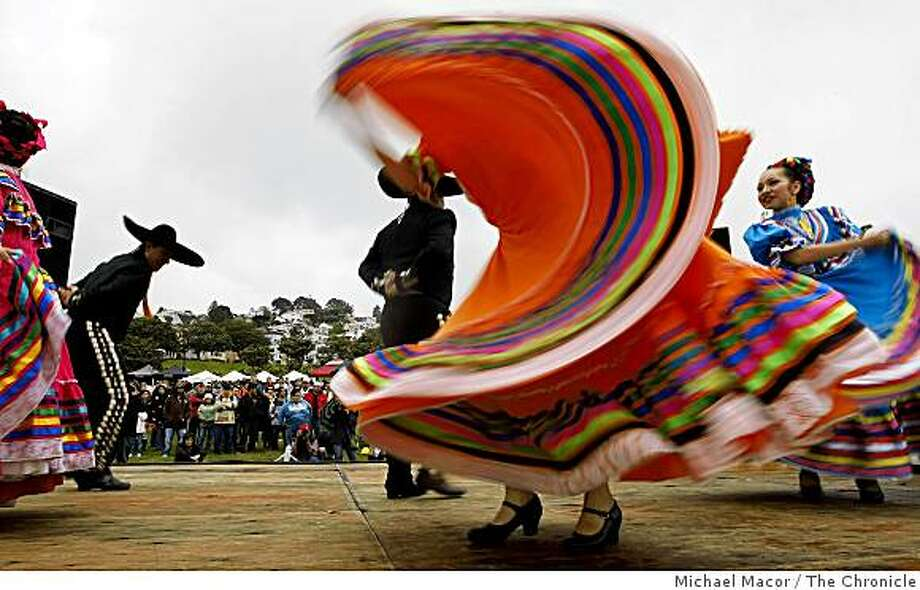 "Dancers with ""Ensambles Ballet Folklorico de San Francsico""  perform a traditional Mexican dance for those gathered for the Cinco de Mayo celebration at Dolores Park on Saturday May 2, 2009, in San Francisco, Calif. Photo: Michael Macor, The Chronicle"