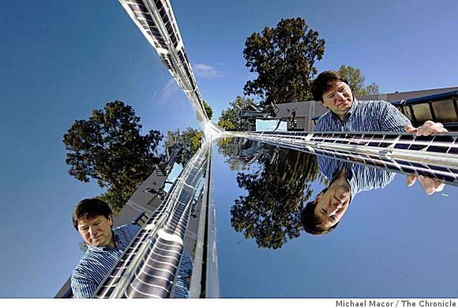 """Executive Chairman, Bill Keating of the solar startup company, """"Skyline Solar"""" in Mountain View, Calif.uses an unusual solar hybrid design of several technologies. Keating, on Wednesday April 29, 2009, poses with the solar collector and the reflective surfaces which focus  sunlight onto the solar cells creating 10 times the energy of a normal collector. Photo: Michael Macor, The Chronicle"""