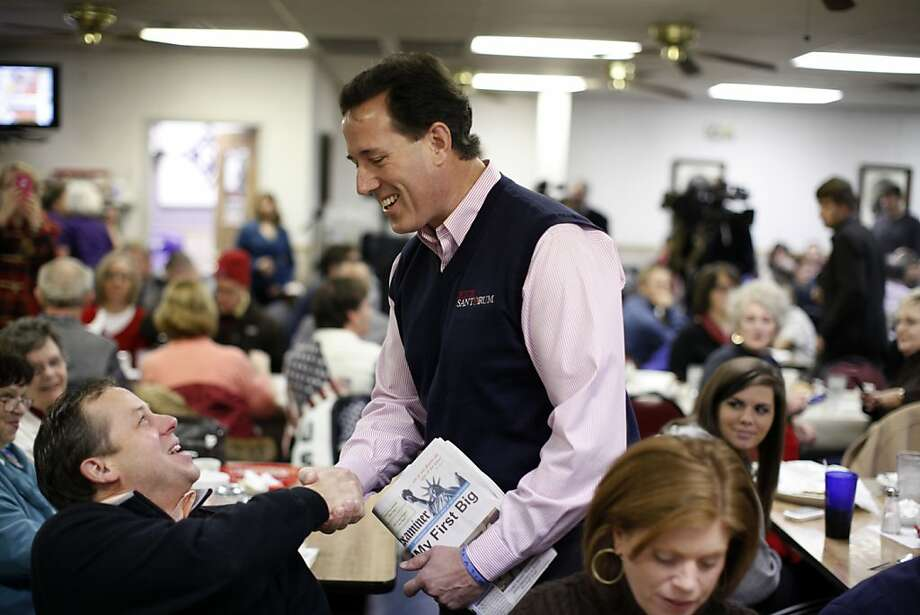 Republican presidential candidate, former Pennsylvania Sen. Rick Santorum, meets patrons of Tommy's Ham House, Saturday, Jan. 14, 2012, during a campaign event in Greenville, S.C. (AP Photo/Matt Rourke) Photo: Matt Rourke, Associated Press