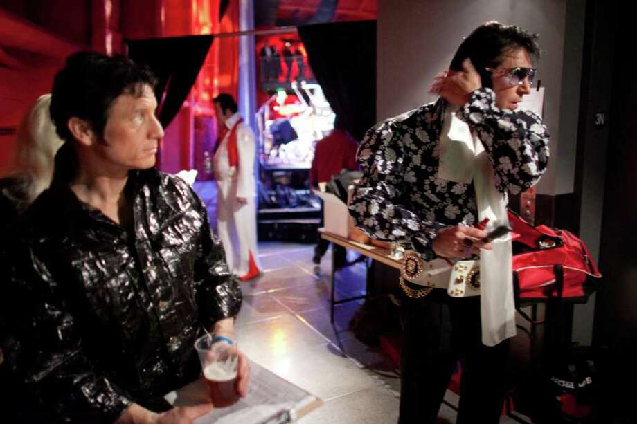 "Elvis, aka Bret Wiggins, right, checks his hair as Elvis, aka KING5's Jim Dever, hangs out backstage during the ""Seattle Invitationals"" Elvis Tribute Artist competition at the EMP. To commemorate the 50th anniversary of the Seattle World's Fair, Elvis returned to the Seattle Center for the 15th annual event on Saturday, January 14, 2012. Photo: JOSHUA TRUJILLO / SEATTLEPI.COM"