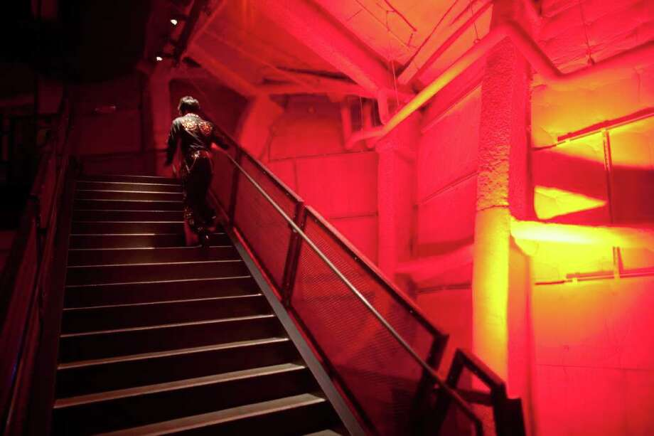 "An Elvis leaves the building during the ""Seattle Invitationals"" Elvis Tribute Artist competition at the EMP. To commemorate the 50th anniversary of the Seattle World's Fair, Elvis returned to the Seattle Center for the 15th annual event on Saturday, January 14, 2012. Photo: JOSHUA TRUJILLO / SEATTLEPI.COM"