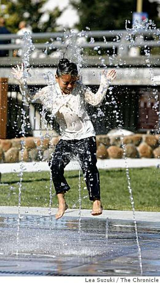 Lizbeth Sagrero (right) , 6, of Santa Rosa goes airborne in the fountain at Prince Gateway Park while playing along with her brother and sister in the water on Sunday, September 21, 2008 in Santa Rosa, Calif. Photo: Lea Suzuki, The Chronicle