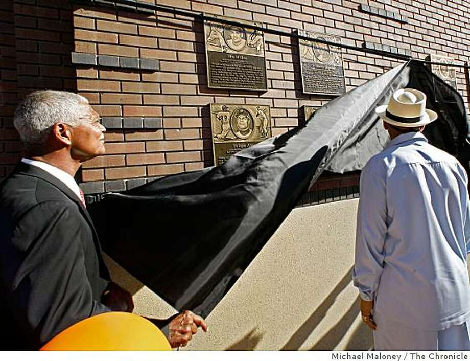 Felipe Alou, left, and Orlando Cepeda unveil their plaques on the Wall of Fame.The SF Giants unveil the Wall of Fame, a tribute to ex-Giants including Willie Mays, Willie McCovey, Orlando Cepeda, Gaylord Perry and many others. The ceremony took place near Willie Mays Plaza, outside  AT&T Park in San Francisco, Calif., on Sept. 23, 2008. Photo: Michael Maloney, The Chronicle