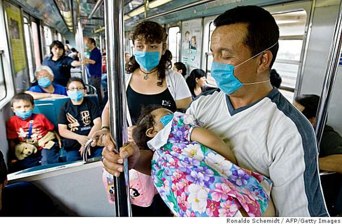 Commuters wear face masks to prevent the infection by the swine flu virus in while travelling aboard Mexico City's subway, on April 24, 2009. An outbreak of deadly swine flu in Mexico and the United States has raised the specter of a new virus against which much of humanity would have little or no immunity. About 950 cases and 60 suspect deaths have been reported in Mexico, according to the World Health Organisation (WHO). The European Centre for Disease Prevention and Control said that the infection of humans with an influenza 'A' virus of animal origins is a concern