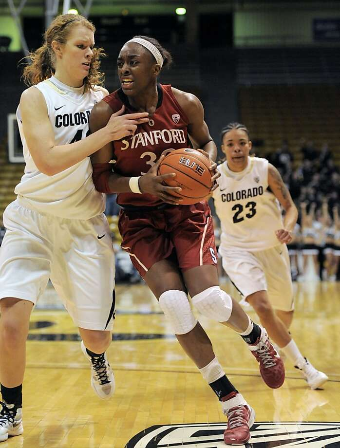 Stanford forward Nnemkadi Ogwumike (30) drives past Colorado center Rachel Hargis (40) during the first half of an NCAA college basketball game in Boulder, Colo., Saturday, Jan. 14, 2012. (AP Photo/ Jack Dempsey) Photo: Jack Dempsey, Associated Press