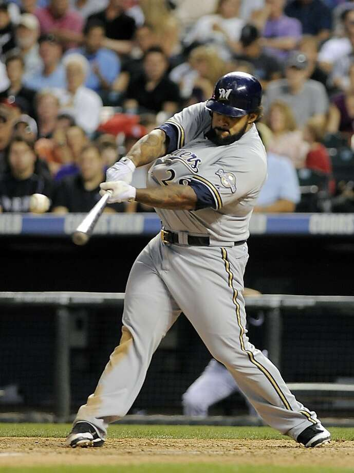 FILE - In this July 15, 2011, file photo, Milwaukee Brewers' Prince Fielder hits a double during the seventh inning of a baseball game against the Colorado Rockies in Denver. A person familiar with the meeting says free agent slugger Prince Fielder is in Texas to talk with the two-time American League champion Texas Rangers on Friday, Jan. 13, 2012. (AP Photo/Chris Schneider, File) Photo: Chris Schneider, Associated Press