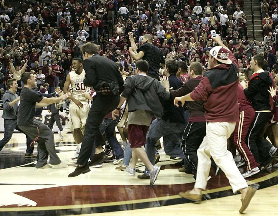 fans storm the floor after Florida State's 90-57 win No. 3 North Carolina in an NCAA college basketball game, Saturday, Jan. 14, 2012 in Tallahassee, Fla.(AP Photo/Steve Cannon) Photo: Steve Cannon, Associated Press