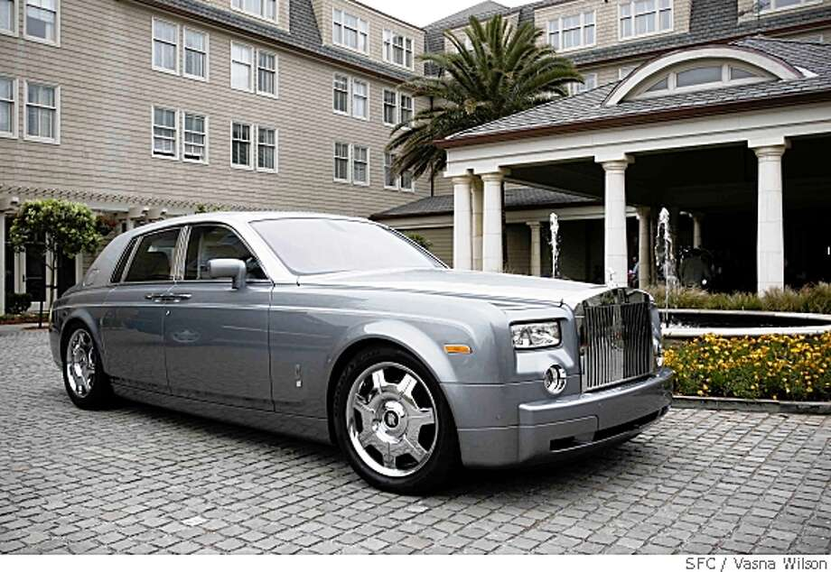 by vasna wilson/special to the chronicle Ran on: 10-01-2007 The Rolls-Royce Phantom makes a big statement at nearly 6½ feet wide and almost 20 feet long, plus nine layers of paint on the outside and plush lambskin carpeting that's a real treat for the feet. Photo: Vasna Wilson, SFC