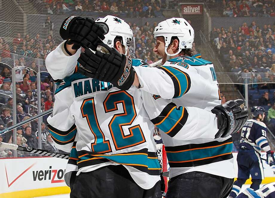 COLUMBUS, OH - JANUARY 14: Patrick Marleau #12 of the San Jose Sharks celibates his third period game winning goal with Joe Thornton #19 to defeat the Columbus Blue Jackets 2-1 at Nationwide Arena on January 14, 2012 in Columbus, Ohio. (Photo by Gregory Shamus/Getty Images) Photo: Gregory Shamus, Getty Images