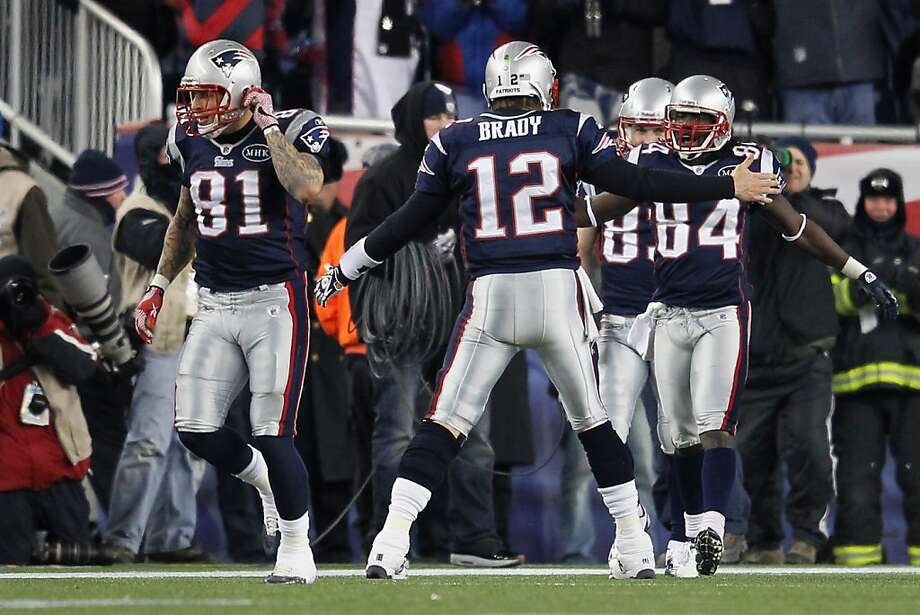 FOXBORO, MA - JANUARY 14:  (L-R) Aaron Hernandez #81, Tom Brady #12 and Deion Branch #84 of the New England Patriots celebrate after Branch caught a 61-yard touchdown reception from Brady in the second quarter against the Denver Broncos during their AFC Divisional Playoff Game at Gillette Stadium on January 14, 2012 in Foxboro, Massachusetts.  (Photo by Jim Rogash/Getty Images) Photo: Jim Rogash, Getty Images