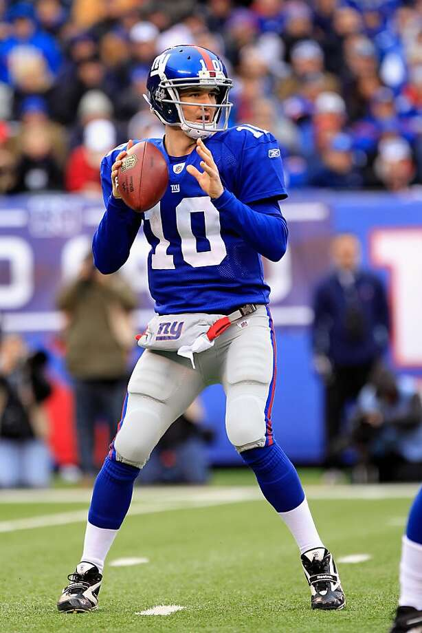 EAST RUTHERFORD, NJ - JANUARY 08:  Eli Manning #10 of the New York Giants looks to throw a pass against the Atlanta Falcons during their NFC Wild Card Playoff game at MetLife Stadium on January 8, 2012 in East Rutherford, New Jersey.  (Photo by Chris Trotman/Getty Images) Photo: Chris Trotman, Getty Images