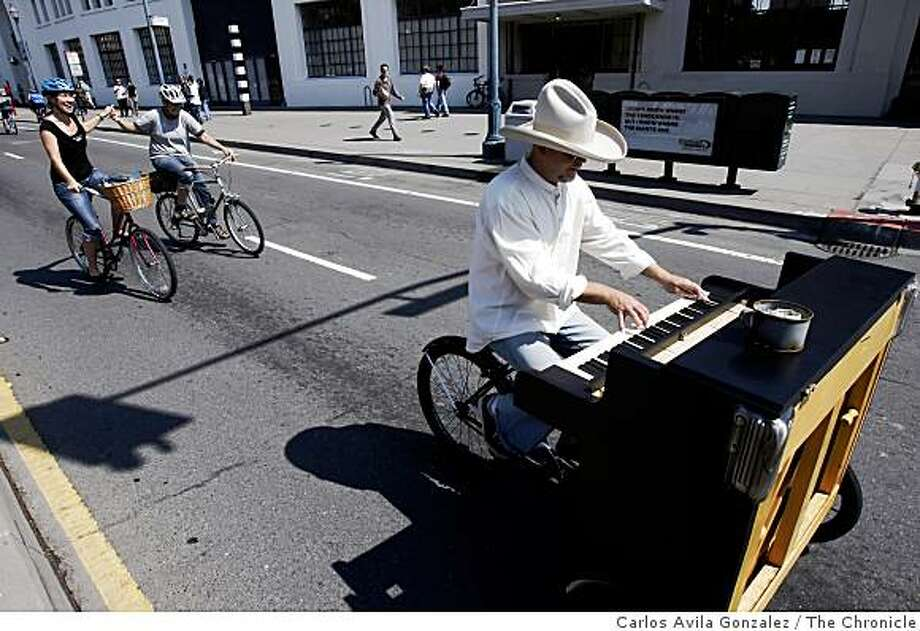 Gary St. Frankenstein plays his modified piano bike on the Embarcadero on Sunday, September 14, 2008, in San Francisco, Calif., during the city's second Sunday Street event. Sunday is the second and last time this year the city experiments with closing down parts of San Francisco to encourage people to get out and about. The city has partnered with more than 100 sponsors and dozens of free activities will be offered along the route. Photo: Carlos Avila Gonzalez, The Chronicle