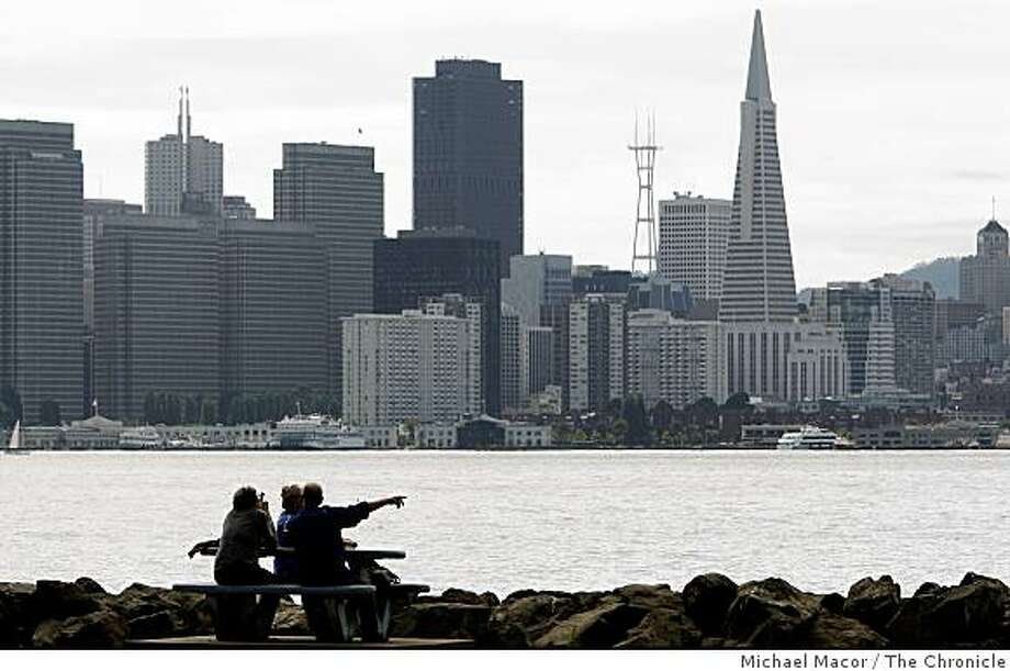 Pepo Angel, Geffy Angel and Brian Baker of Paris France, enjoy an afternoon on Treasure Island during their two week holiday in San Francisco, Calif., taking in the spectacular views against the city skyline on Sept. 19, 2008. Photo: Michael Macor, The Chronicle
