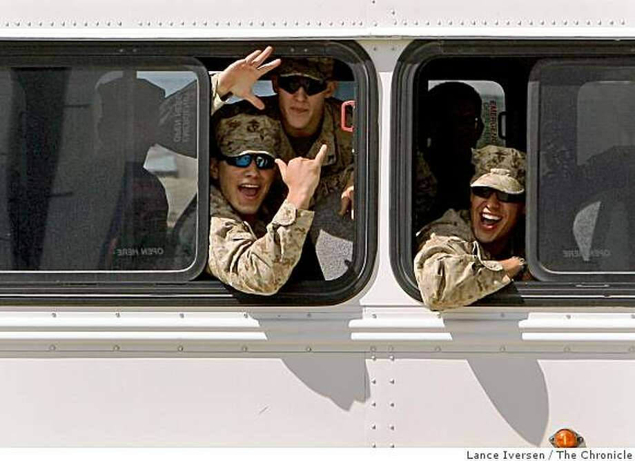 Members of India and Kilo company yell out to family and friends as their buses pull up for their reunion. The first Marine battalion to be sent to Iraq for a fifth tour returned to their home base in Twenty Nine Palms, Calif., on Thursday Sept 18, 2008. Photo: Lance Iversen, The Chronicle