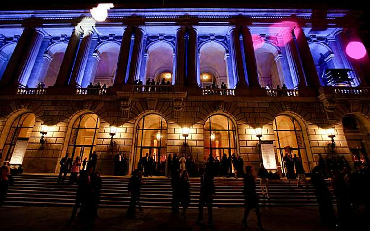 The War Memorial Opera House glows in color during the 2010 Black and White Ball, in San Francisco, Calif. on Saturday May 22, 2010, benefitting the San Francisco Symphony's, Adventures In Music program, which brings music into the lives of every single student in grades K-5 in the San Francisco School District.