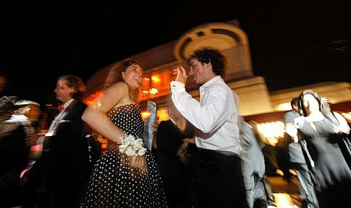 Fermanda Schlender and Olin Montalvo tear up the dance floor outside of Davies Symphony Hall at the 2010 Black and White Ball, in San Francisco, Calif. on Saturday May 22, 2010.