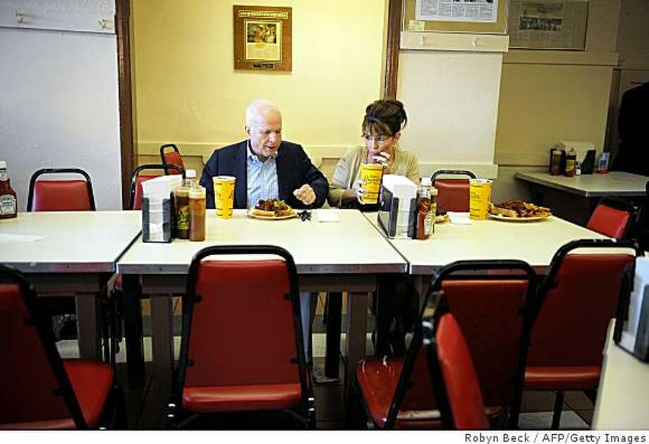 Republican presidential candidate John McCain and his running mate Alaska Governor Sarah Palin have a meal at Arthur Bryant's Barbeque restaurant in Kansas City, Missouri on September 7, 2008. Photo: Robyn Beck, AFP/Getty Images