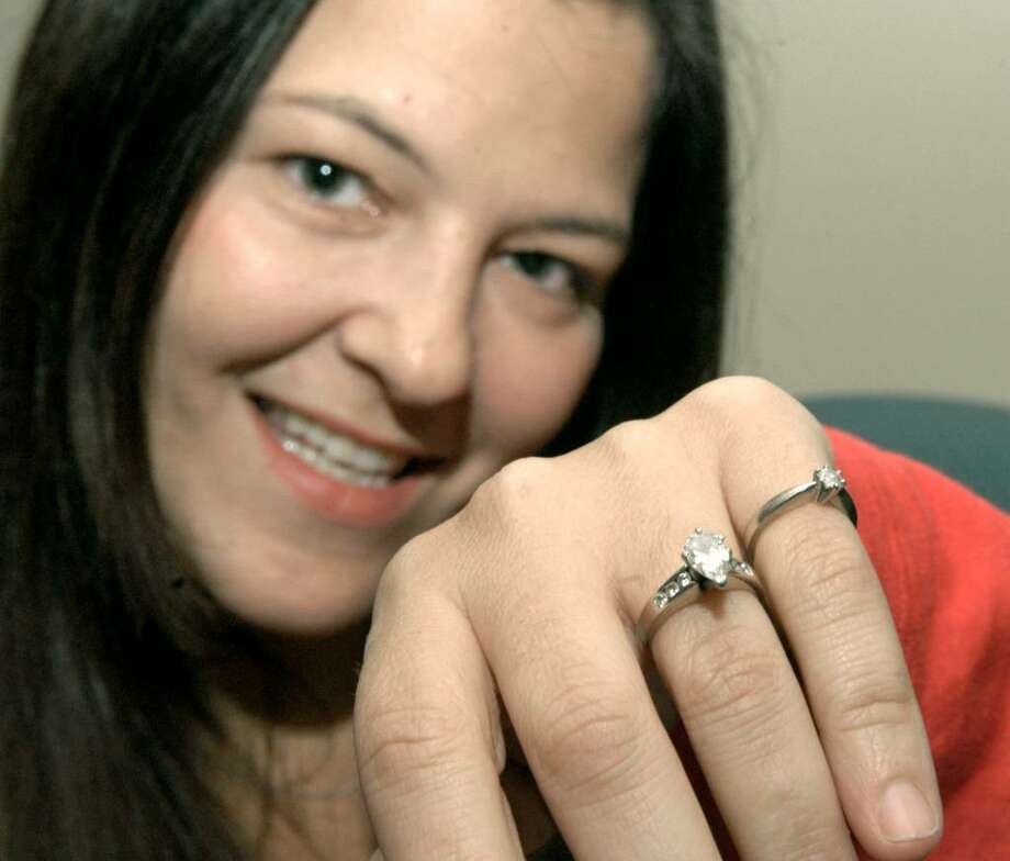 Heather Moran, 35,of Bethel lost her engagement ring at Walmart in Danbury. Britta Wasloff, a Walmart employee, found it. Photo: Carol Kaliff / The News-Times