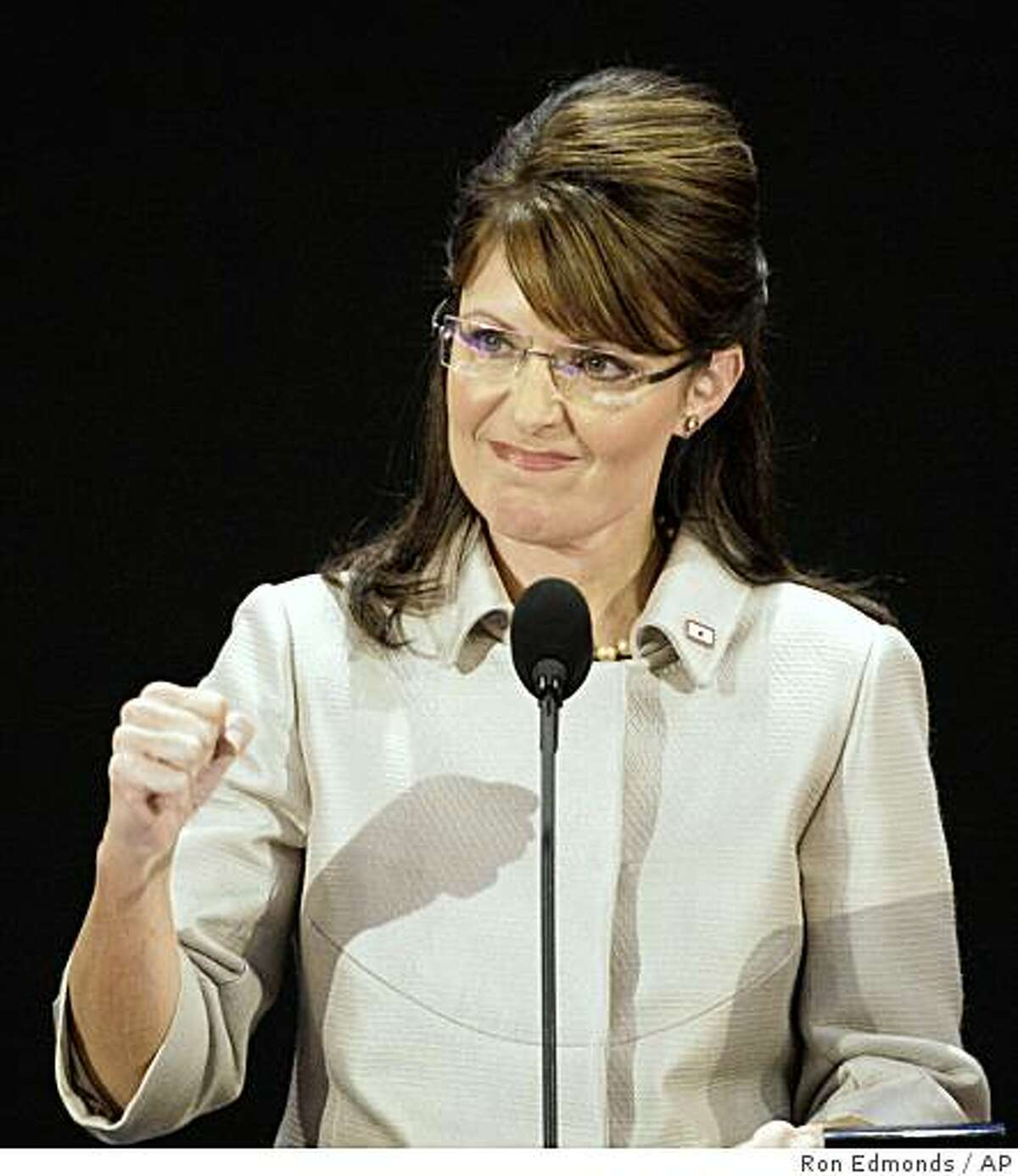 Republican vice presidential candidate Sarah Palin pumps her fist during her speech at the Republican National Convention.