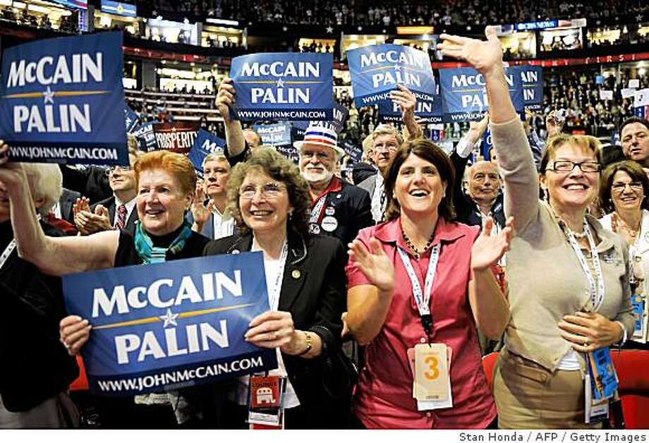 Women hold up signs in support of John McCain, the presumptive Republican presidential nominee and vice presidential pick Sarah Palin. Photo: Stan Honda, AFP / Getty Images
