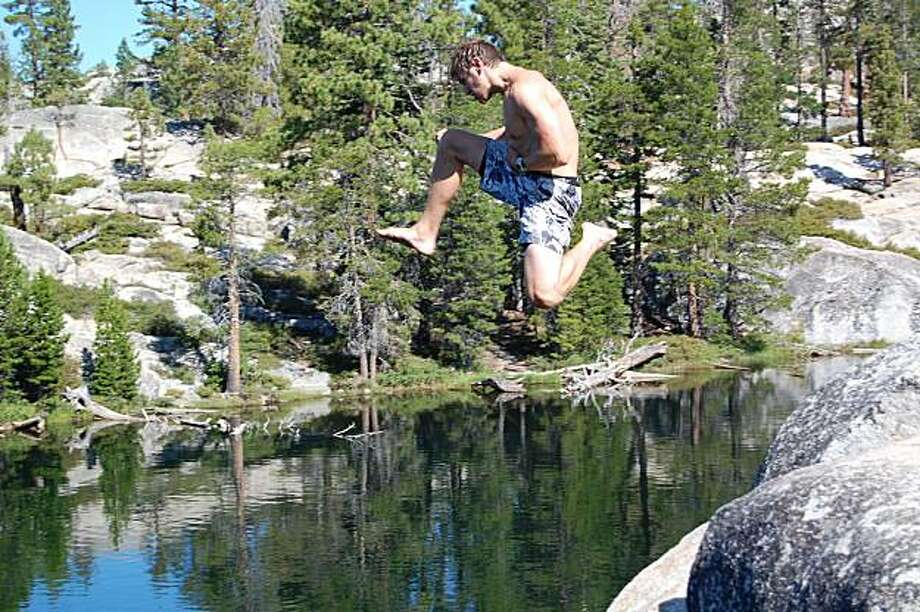 Cliff-jumping at Sword Lake, located in the Carson-Iceberg Wilderness in the Sierra. Photo: Brian Repp