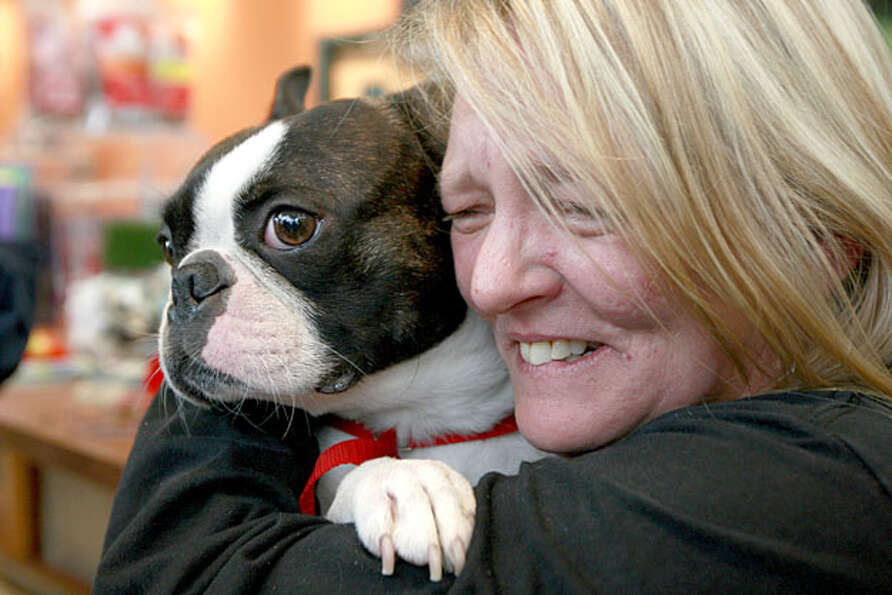 Denise Shepard is reunited with her Boston terrier Frankie on Tuesday, May 11, 2010 at Wheeling Anim