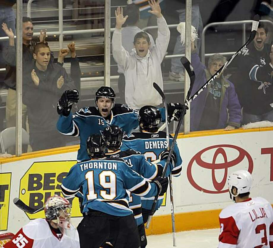 Dany Heatley celebrates his first period goal with teammates in the first period. The San Jose Sharks played the Detroit Red Wings at HP Pavilion in San Jose, Calif., on Thursday, April 29, 2010 in Game one of the Western Conference Semifinals. Photo: Carlos Avila Gonzalez, The Chronicle