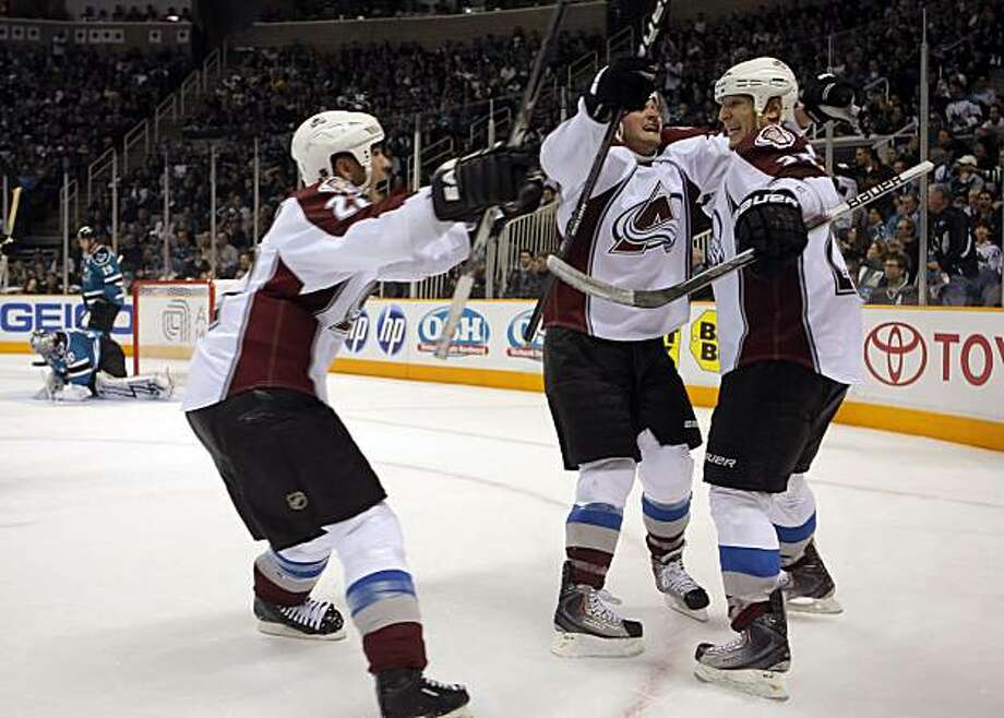Colorado's Scott Hannan, left, TJ Galiardi, center, and Chris Stewart, right, celebrate Stewart's game winning goal in the final minute Wednesday. Photo: Carlos Avila Gonzalez, The Chronicle