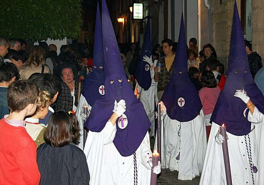 During Spain's Semana Santa (Holy Week), parading penitents dress in robes with pointed hoods. Photo: Rick Steves