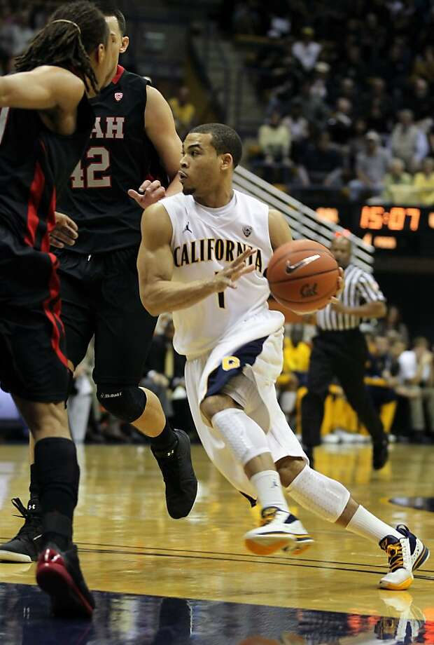 California's Justin Cobbs (1) drives to the basket against Utah's Dijon Farr(32) and Javon Dawson (10), right, during the first half of an NCAA college basketball game, Saturday, Jan. 14, 2012, in Berkeley, California. Photo: Lance Iversen, The Chronicle