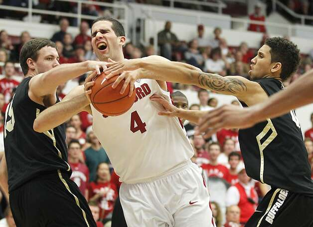 Stanford's Stefan Nastic (4) reacts as he is fouled by Colorado's Shane Harris-Tunks (15) and Colorado's Askia Booker, right, in the second half of an NCAA college basketball game on Saturday, Jan. 14, 2012, in Stanford, Calif. Stanford won 84-64. Photo: Tony Avelar, Associated Press