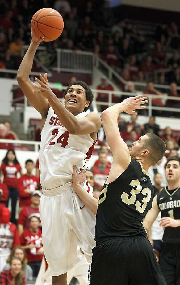 Stanford's Josh Huestis (24) shoots over Colorado's Austin Dufault (33) in the second half of an NCAA college basketball game on Saturday, Jan. 14, 2012, in Stanford, Calif. Stanford won 84-64. (AP Photo/Tony Avelar) Photo: Tony Avelar, Associated Press