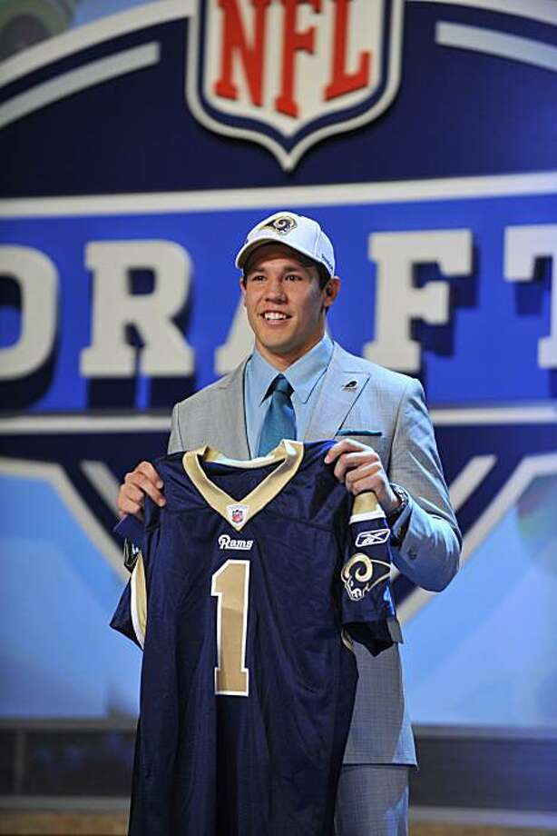Oklahoma quarterback Sam Bradford smiles as he holds up a jersey after he was selected as the No. 1 overall pick by the St. Louis Rams in the first round of the NFL Draft at Radio City Music Hall, Thursday, April 22, 2010, in New York. Photo: Stephen Chernin, AP