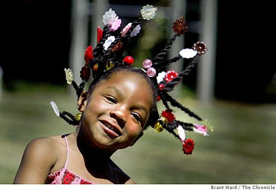 Four year old Ke'seana Sanders of Oakland let her hair do some rocking as she listened to a band at The Comedy On The Green event Sunday. The Comedy On The Green at Arroyo Park event in Oakland, Calif. took on special significance Sunday August 10, 2008 as the comedian Bernie Mac is remembered by the comedians. Photo: Brant Ward, The Chronicle
