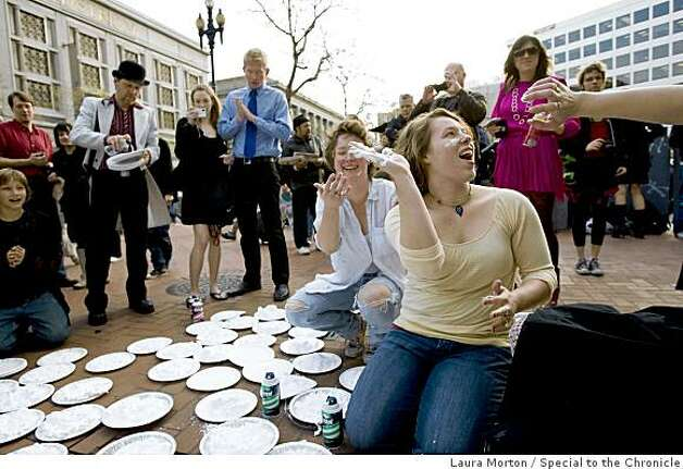 Participants in a flash mob pie fight, including Erin Dean (right), joke around while getting their pies ready at the Powell and Market cable car turn around in San Francisco, Calif., on Thursday, March 5, 2008. Photo: Laura Morton, Special To The Chronicle